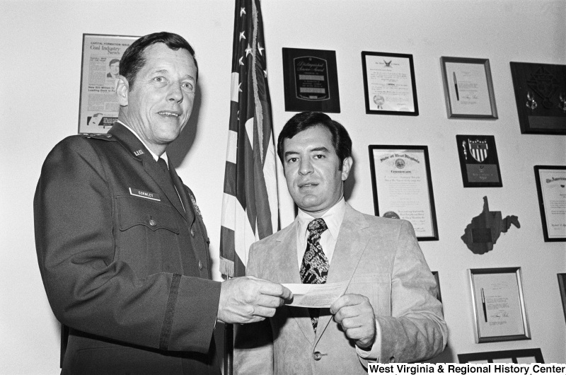 Congressman Rahall holds a document with U.S. military officer Gormley.