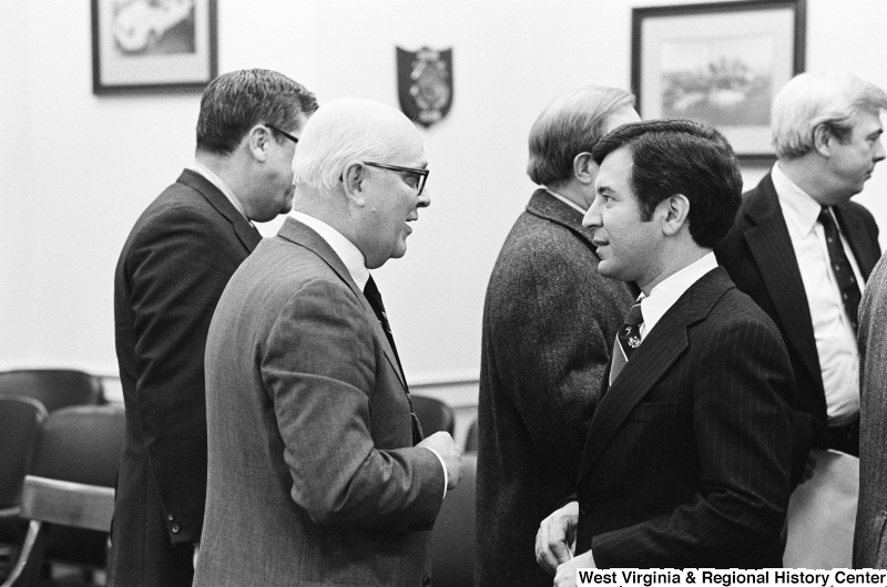 Congressman Rahall talks with other men.