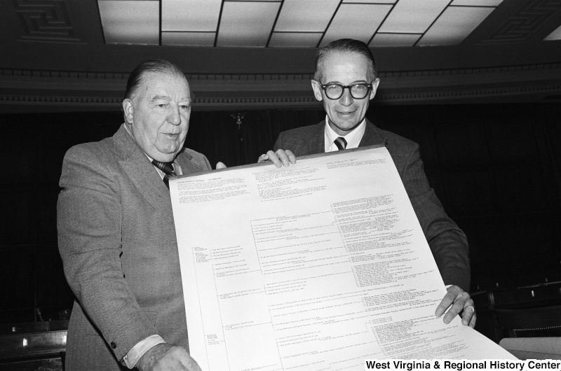 Jennings Randolph and another man hold a large print of a Washington family tree.