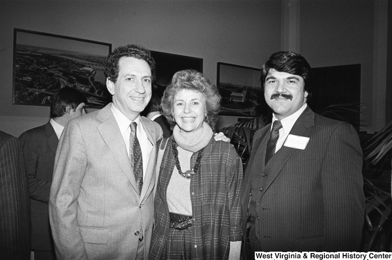 Richard Trumka stands next to a man and woman.