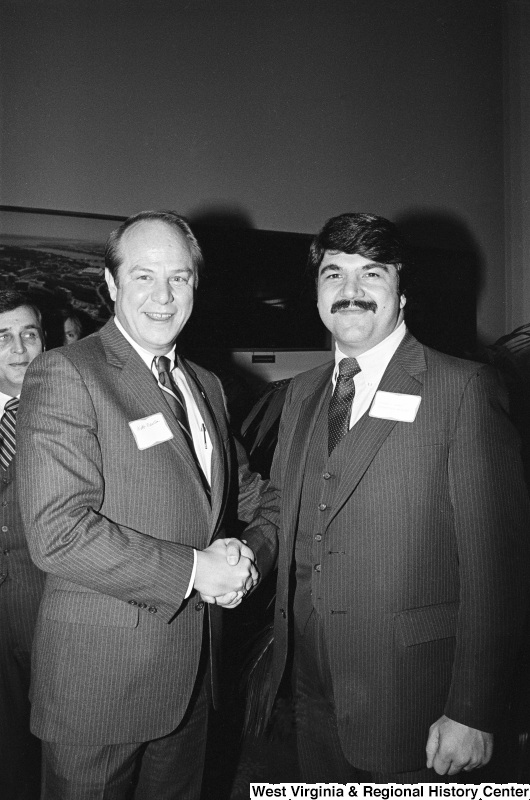 Webb Franklin shakes hands with Richard Trumka.