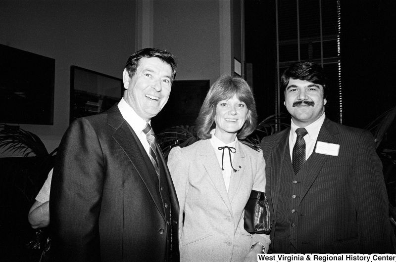 Austin Murphy, Richard Trumka, and a woman pose for a photo.