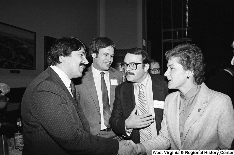 Photograph of Congressman Lane Evans, Congresswoman Marcy Kaptur, Richard Trumka, and others at an event
