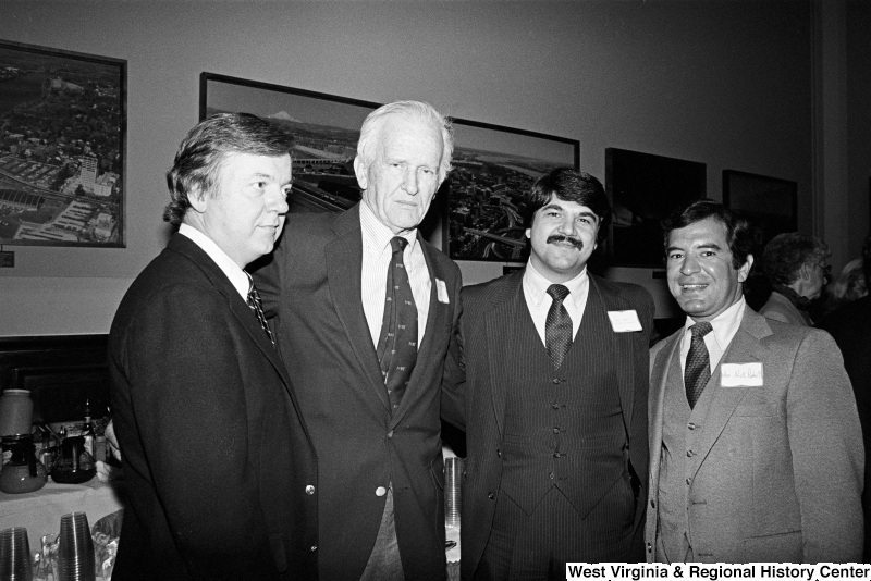 Photograph of Representative Nick Rahall, Richard Trumka, and unidentified people at event