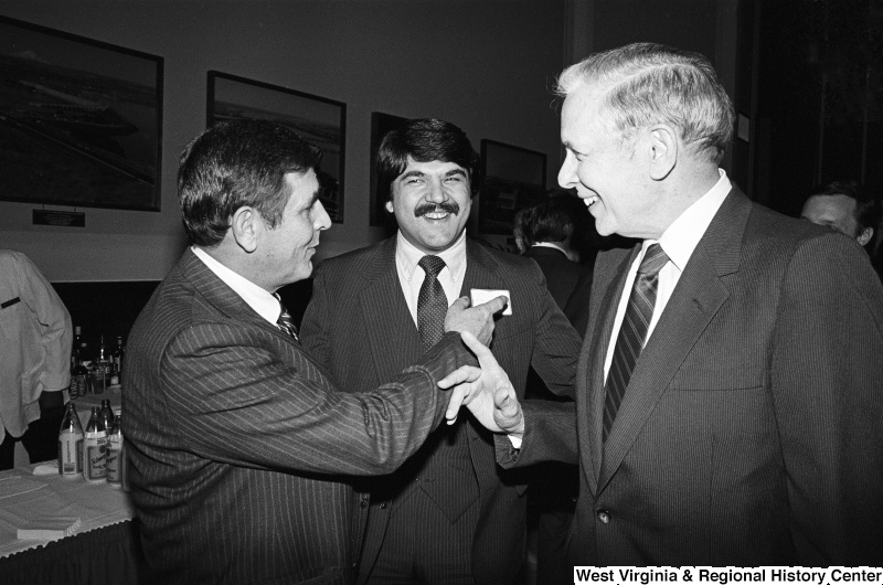 Photograph of Congressman Tom Bevill (AL), Richard Trumka, and an unidentified person at an event