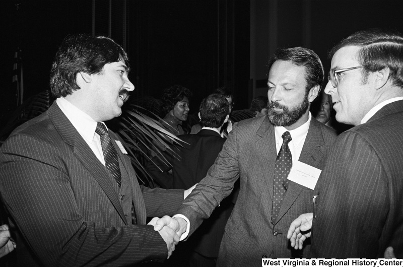 Photograph of Congressman David Bonior (MI), Richard Trumka, and an unidentified person