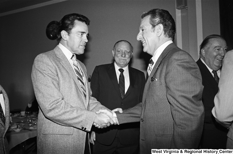 Photograph of Congressmen Douglas Applegate (OH) and Joseph Addabbo (NY) with actor Danny Thomas