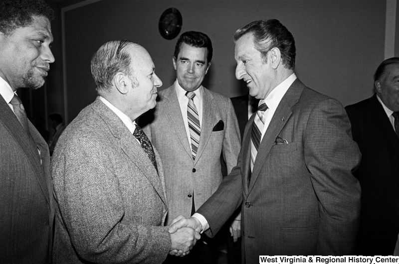 Photograph of Congressmen Frank Annunzio (IL), Douglas Applegate (OH), and Mickey Leland (TX) with actor Danny Thomas