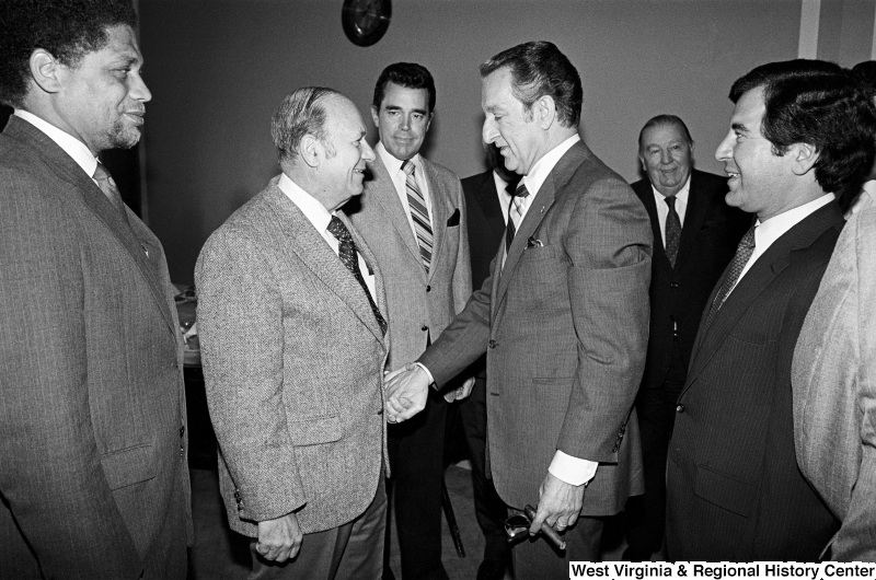 Photograph of Congressmen Mickey Leland (TX), Frank Annunzio (IL), Douglas Applegate (OH), and Nick Rahall (WV) with actor Danny Thomas