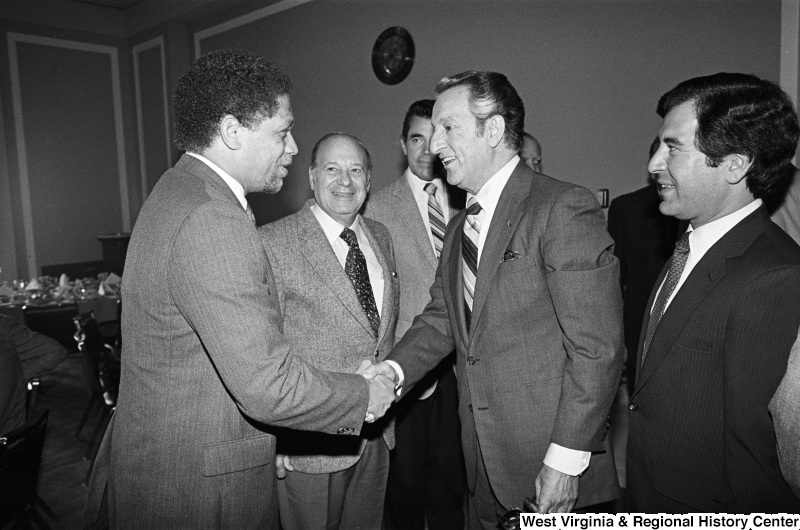 Photograph of Congressmen Mickey Leland (TX), Nick Rahall (WV), and Frank Annunzio (IL) with actor Danny Thomas