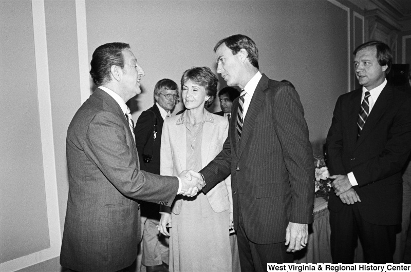 Photograph of a group of unidentified congressmen/women with actor Danny Thomas