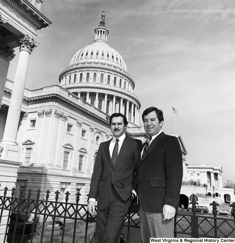 Photograph of Representative Nick Rahall and an unidentified person on the Capitol Building steps
