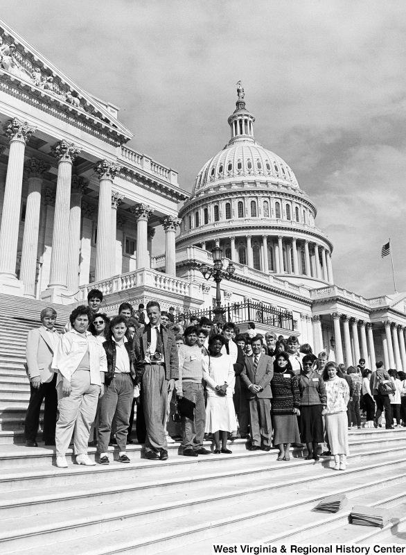 Photograph of Representative Nick Rahall with a group of unidentified people on the steps of the Capitol Building