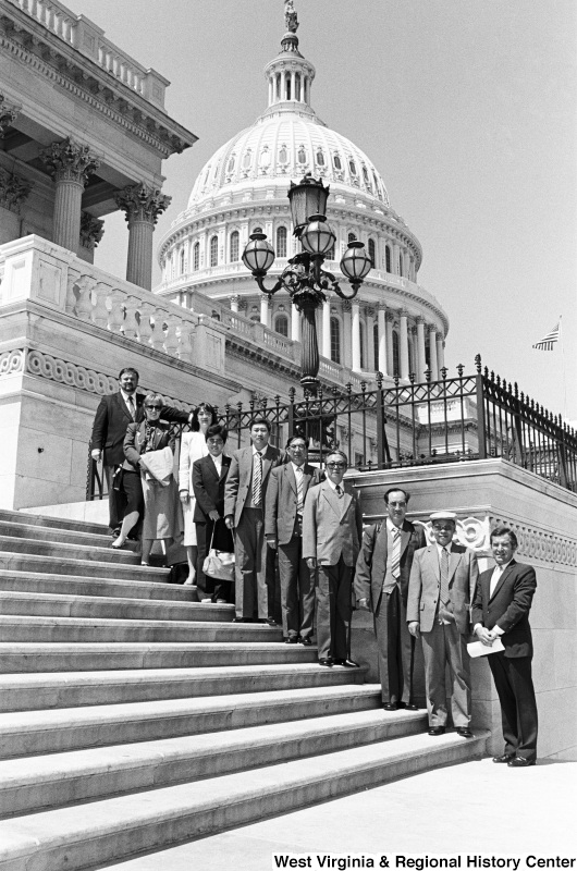 Photograph of an unidentified group of people standing on the Capitol Building steps