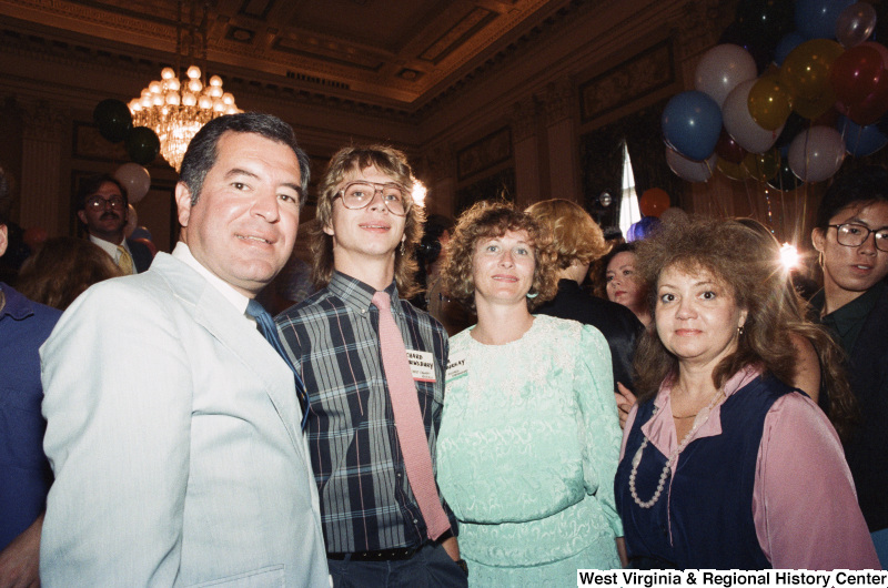 Photograph of Congressman Nick Rahall with three unidentified people at an unidentified event