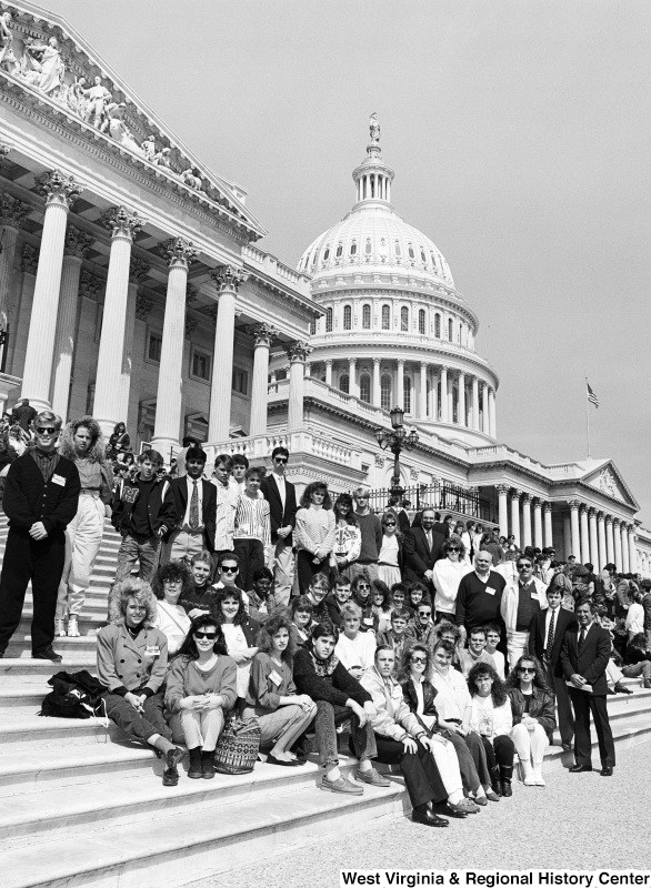 Photograph of Congressman Nick Rahall with a group of unidentified people on the steps of the Capitol
