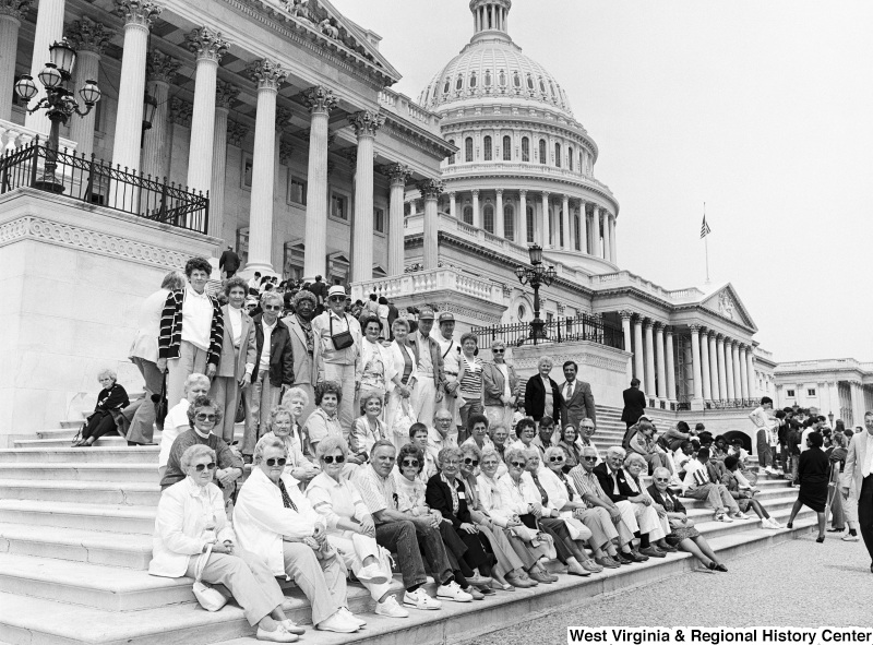 Photograph of Congressman Nick Rahall on the steps of the Capitol with a group of unidentified people