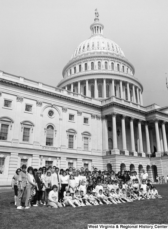 Photograph of Congressman Nick Rahall at the Capitol Building with a group of unidentified people