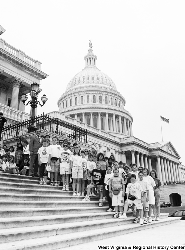Photograph of an unidentified group of people with Congressman Nick Rahall on the steps of the Capitol