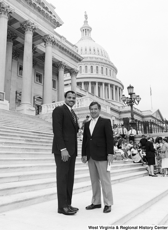 Photograph of Congressman Nick Rahall with an unidentified man on the Capitol steps
