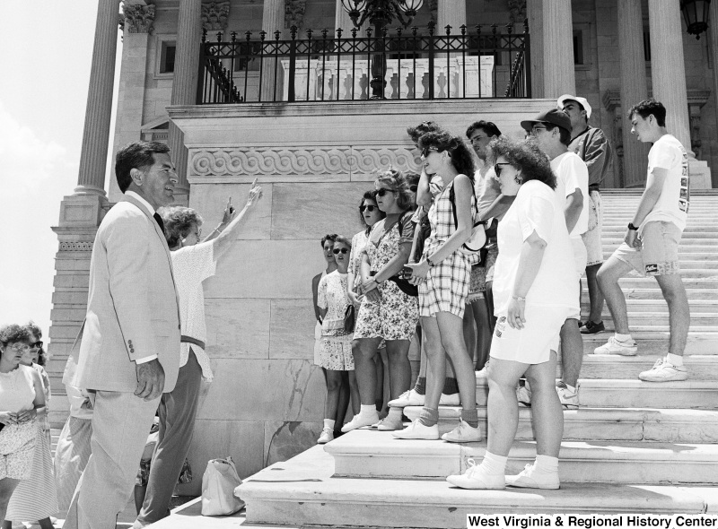 Photograph of Congressman Nick J. Rahall with an unidentified group on the Capitol steps