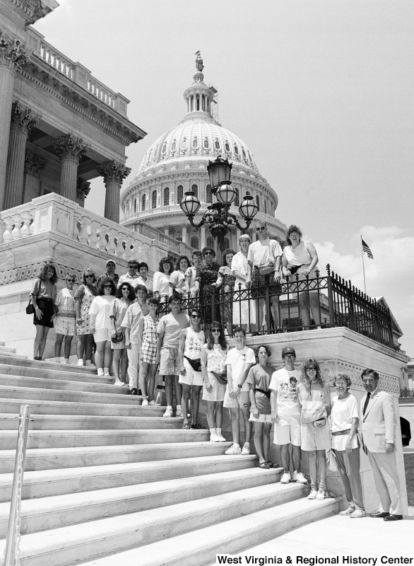 Photograph of an unidentified group of people with Congressman Nick J. Rahall