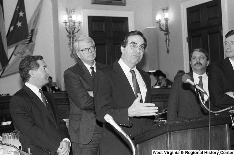 Photograph of Congressmen Nick Rahall, George Miller, Bruce Vento, and Sam Gejdenson at an event