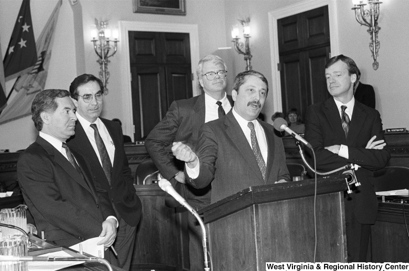 Photograph of Congressmen Nick Rahall, George Miller, Sam Gejdenson, Peter Kostmayer, and Bruce Vento speaking at an event