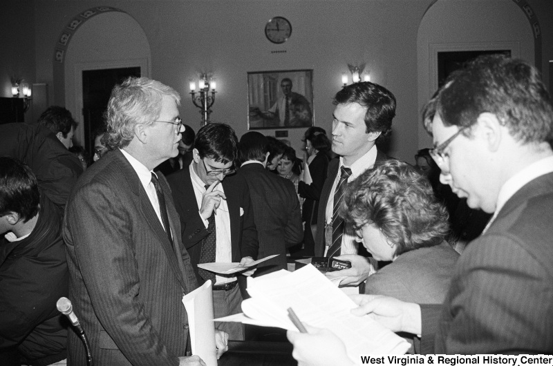Photograph of Congressman George Miller speaking with an unidentified person