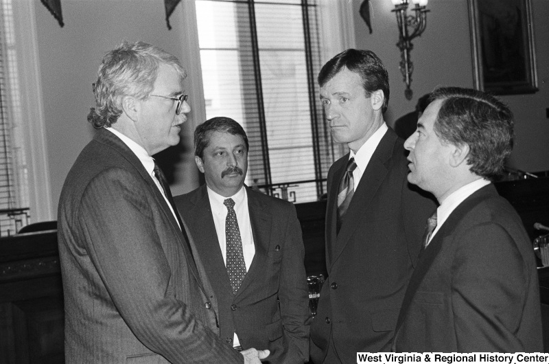 Photograph of Congressmen Nick Rahall, Sam Gejdenson, George Miller, and Peter Kostmayer at an event