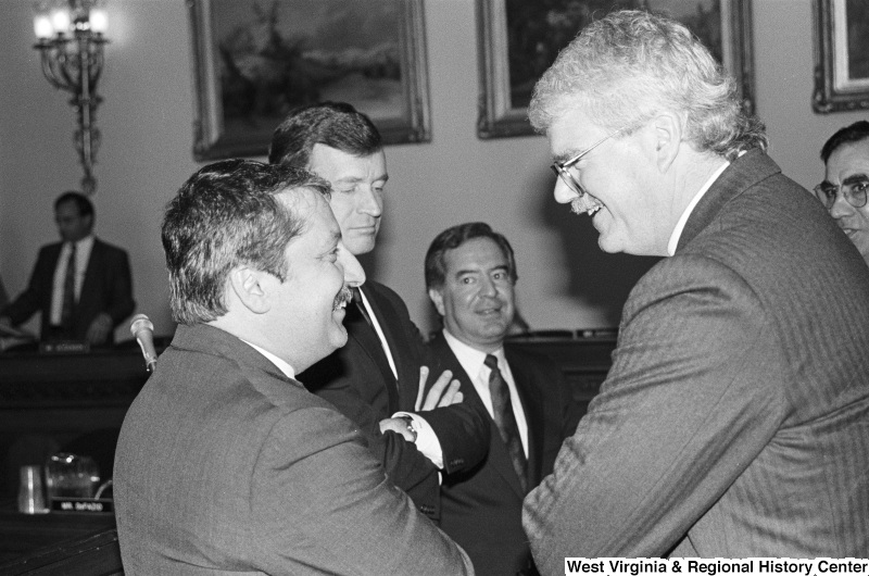 Photograph of Congressmen Nick Rahall, George Miller, Sam Gejdenson, and Peter Kostmayer at an event