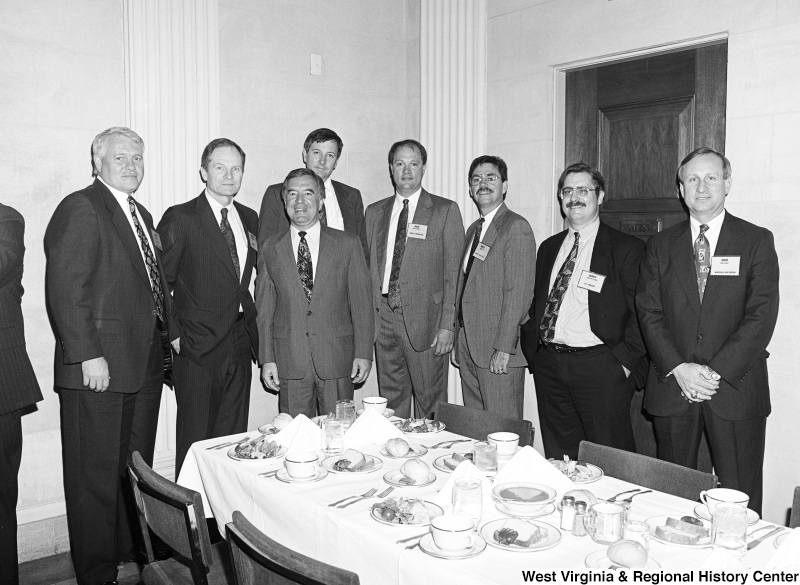 Photograph of Congressman Nick Rahall with Don Seale from Norfolk-Southern, Jerry Syster from A.T. Massey, and five other company representatives