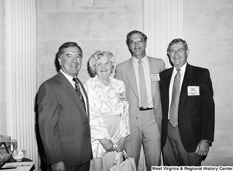 Photograph of Congressman Nick Rahall with Anne Barringer, Virginia Coal Council Ambassador, Roger Sindelat(?) of St. Lawrence Seaway Development Coorporation, and Bruce Beam of American Electric Power.