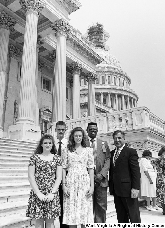 Photograph of Congressman Nick Rahall with four unidentified people