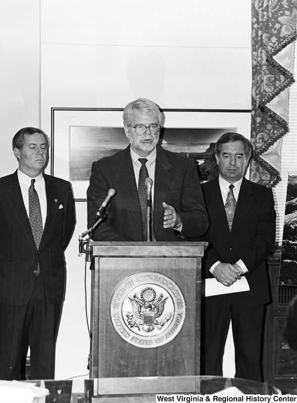 Photograph of Congressmen Nick Rahall and George Miller speaking at an unidentified event