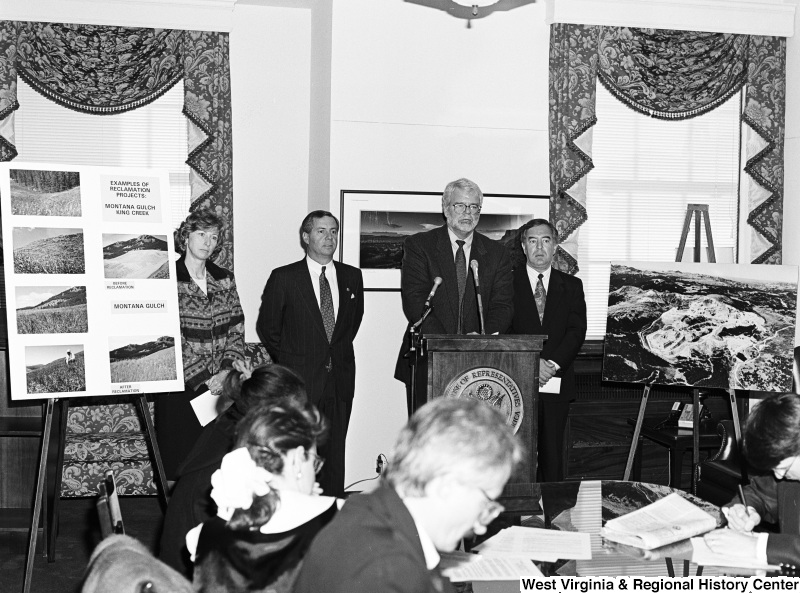 Photograph of Congressmen Nick Rahall and George Miller speaking at an unidentified press conference