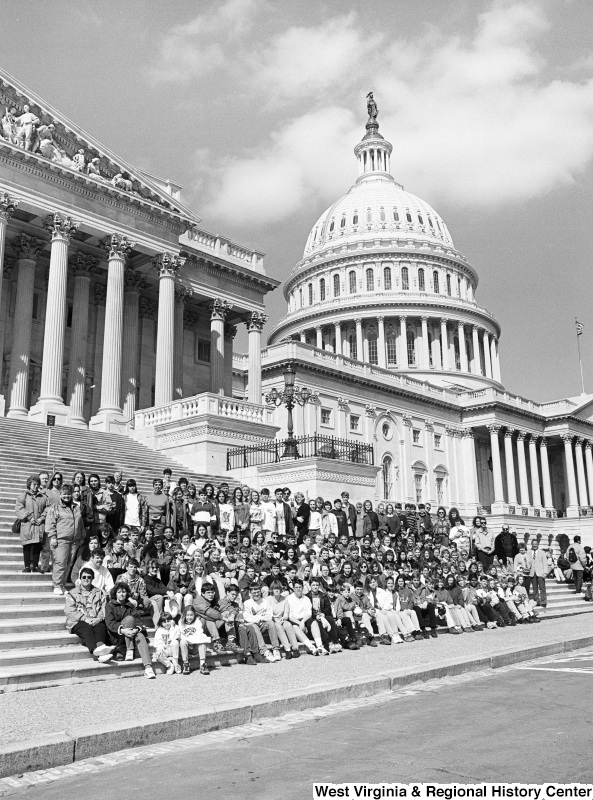 Photograph of Congressman Nick Rahall with an unidentified group outside of the Capitol Building