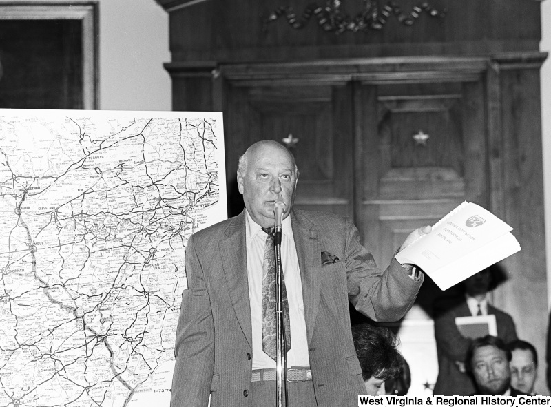 Photograph of an unidentified representative speaking on the Virginia opposition to Corridor 6A, Route 460
