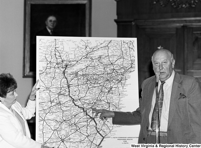 Photograph of an unidentified representative speaking on the proposed route for I-73/74