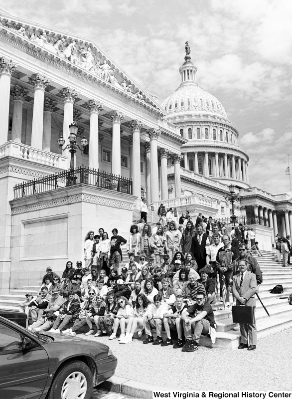 Photograph of a group of unidentified people at the Capitol Building with Congressman Nick Rahall