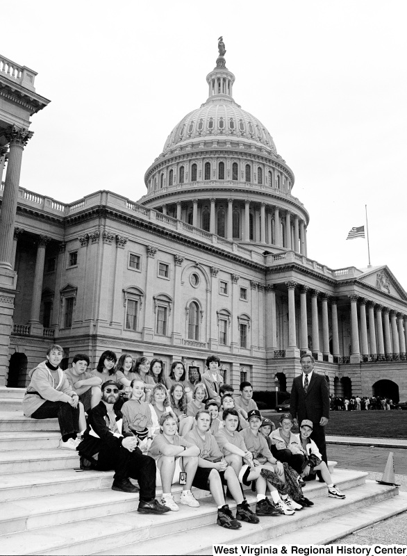 Photograph of Congressman Nick Rahall outside of the Capitol Building with an unidentified school group