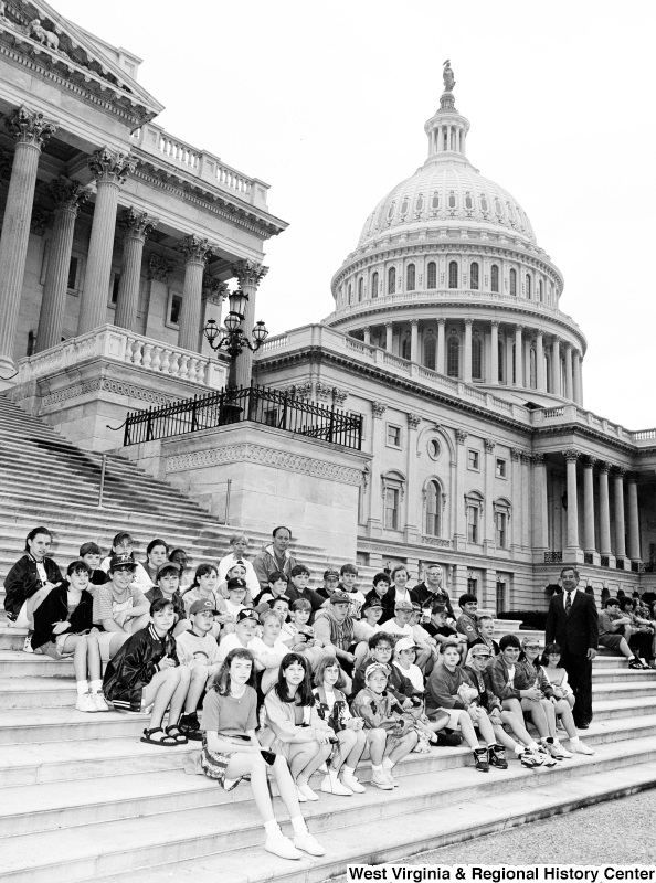 Photograph of Congressman Nick Rahall with an unidentified school group at the Capitol Building