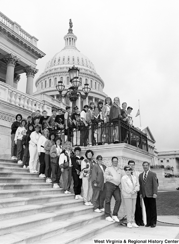 Photograph of Congressman Nick Rahall at the Capitol with an unidentified group of people