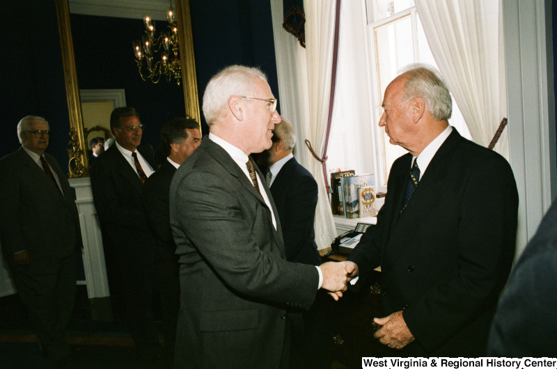 Photograph of Congressman Victor Fazio (CA) shaking hands with an unidentified foreign dignitary