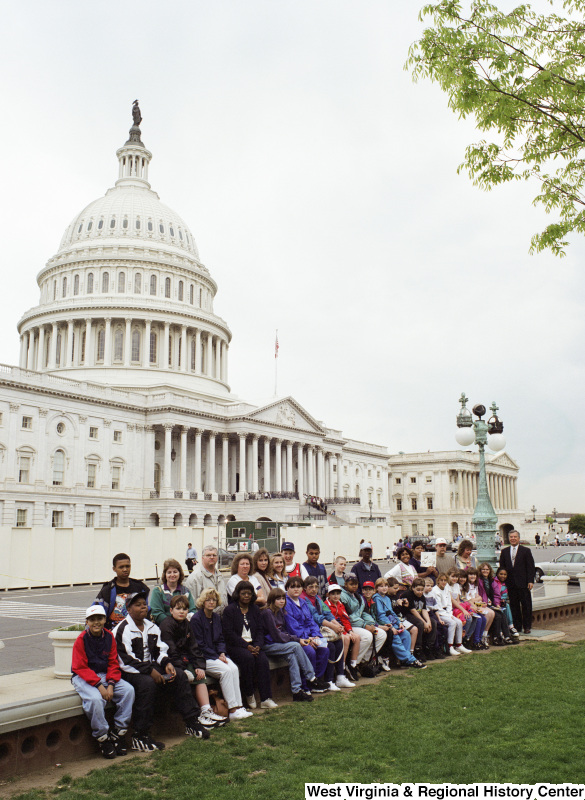Photograph of Congressman Nick Rahall and an unidentified school group outside of the Capitol Building