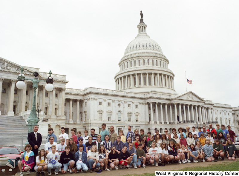 Photograph of Congressman Nick Rahall posing with a group of unidentified students at the Capitol Building
