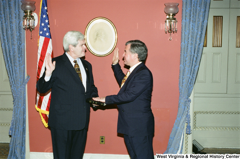 Photograph of Speaker of the House Newt Gingrich and Congressman Nick Rahall at a swearing-in ceremony