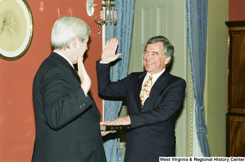 Photograph of Congressman Nick Rahall and Newt Gingrich at a swearing-in ceremony