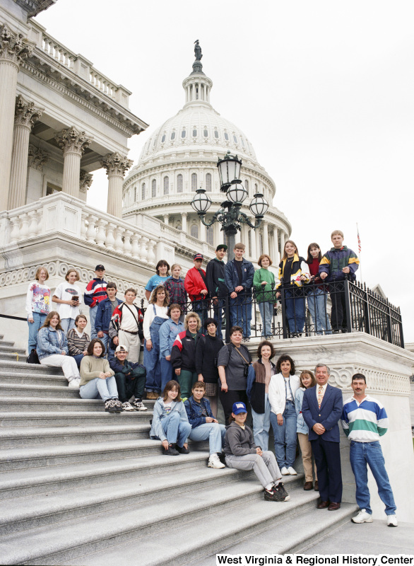 Photograph of Congressman Nick Rahall posing at the Capitol with a group of unidentified people
