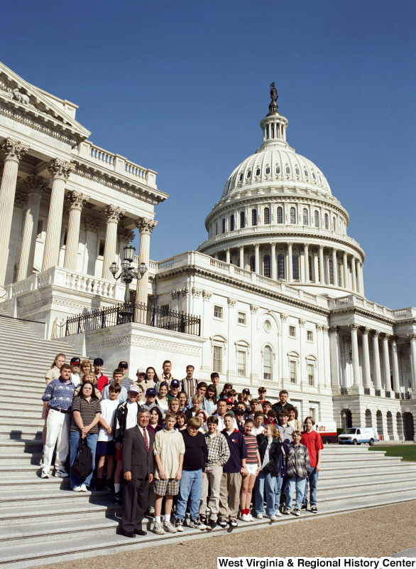 Photograph of Congressman Nick J. Rahall posing with a group of unidentified students at the Capitol